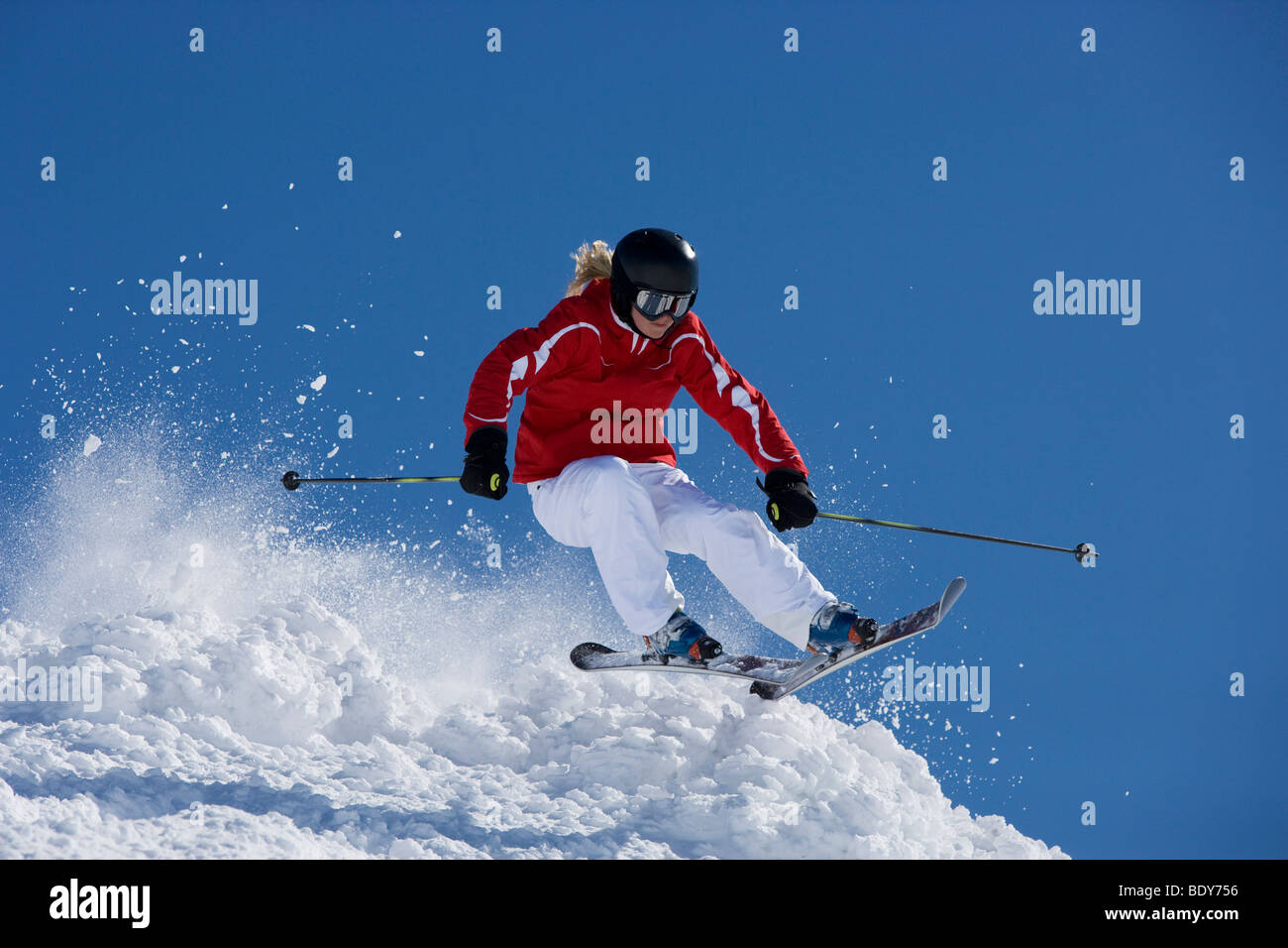 Girl in red getting air time. - Stock Image