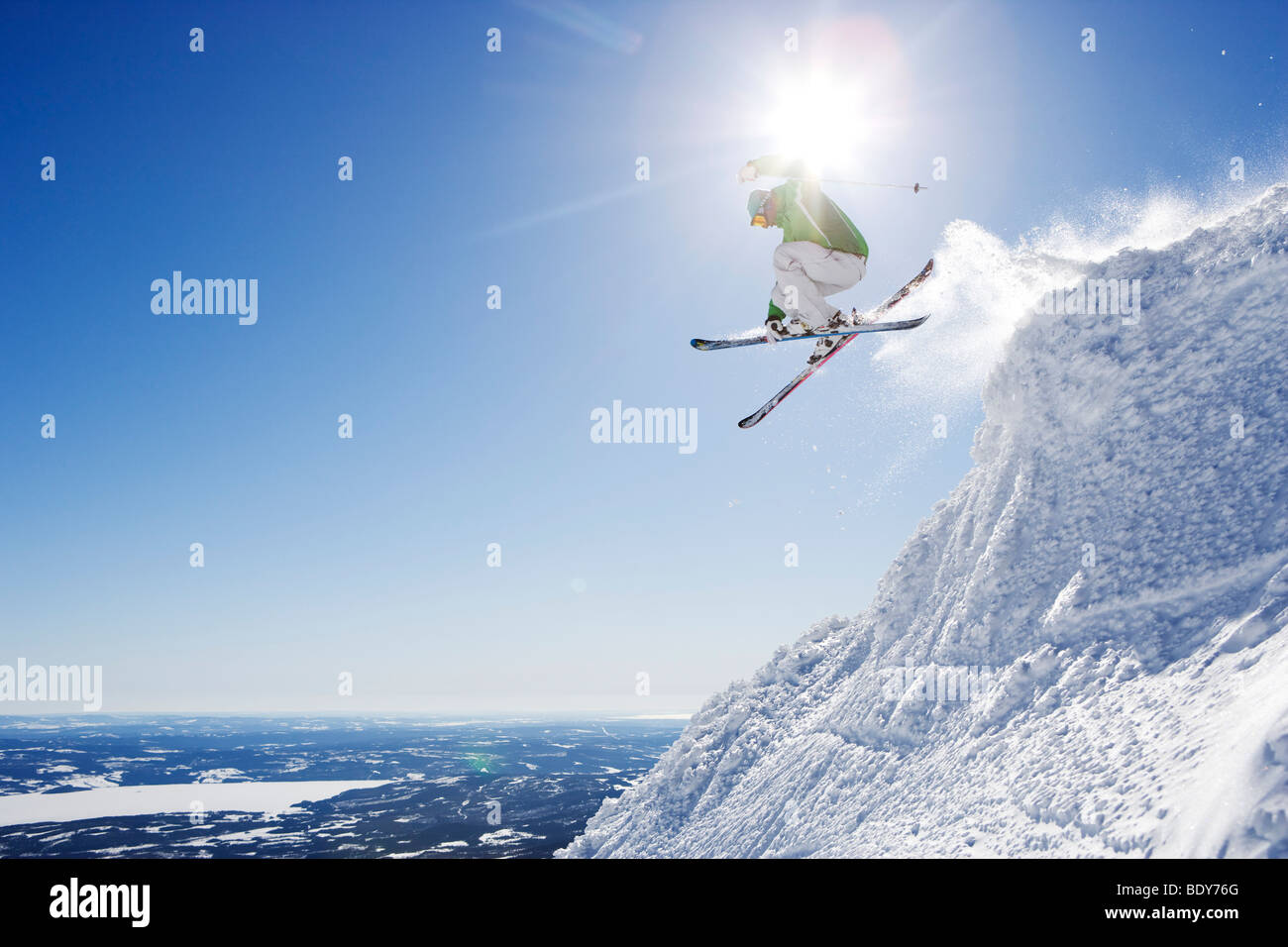 Man in green getting air-time. - Stock Image