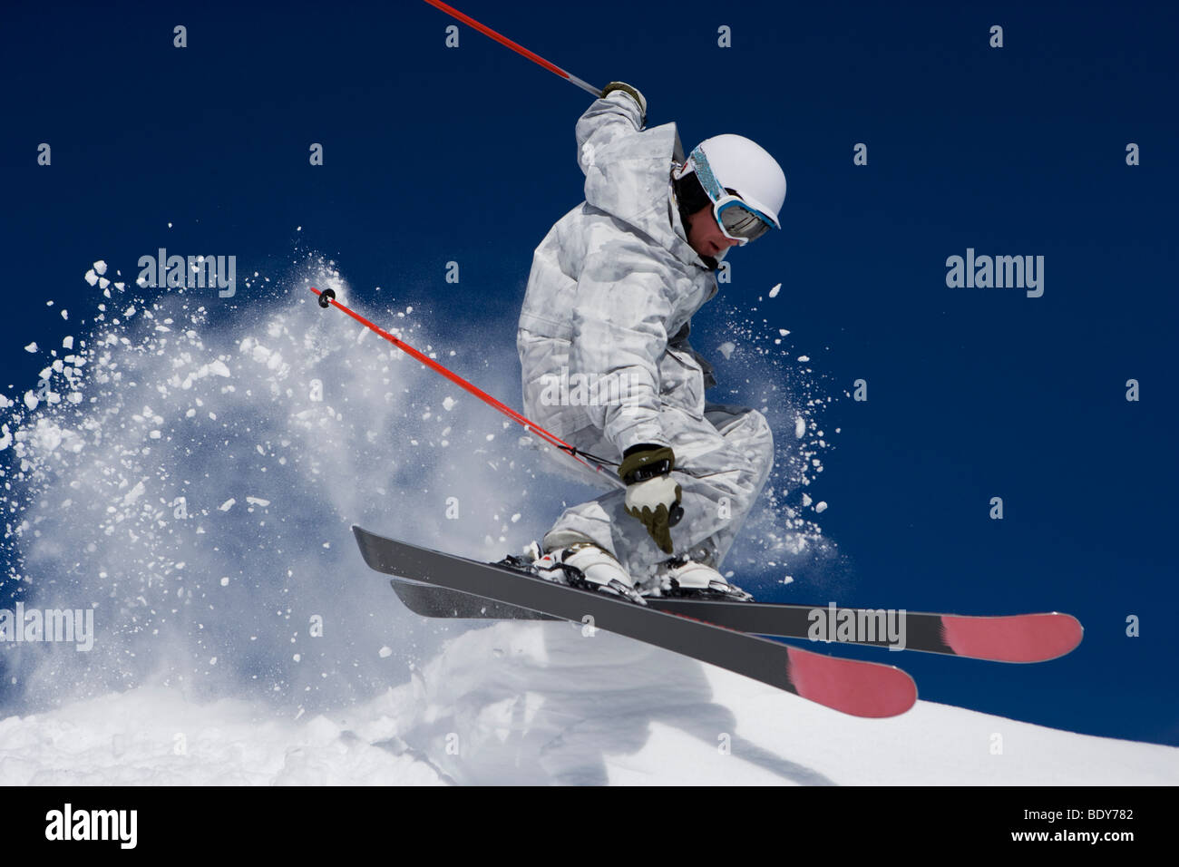 Man in white & grey camo suit off-piste. - Stock Image