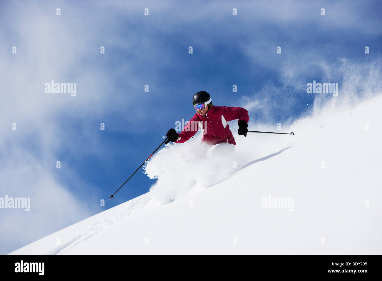 Woman in red & white outfit carving. Stock Photo