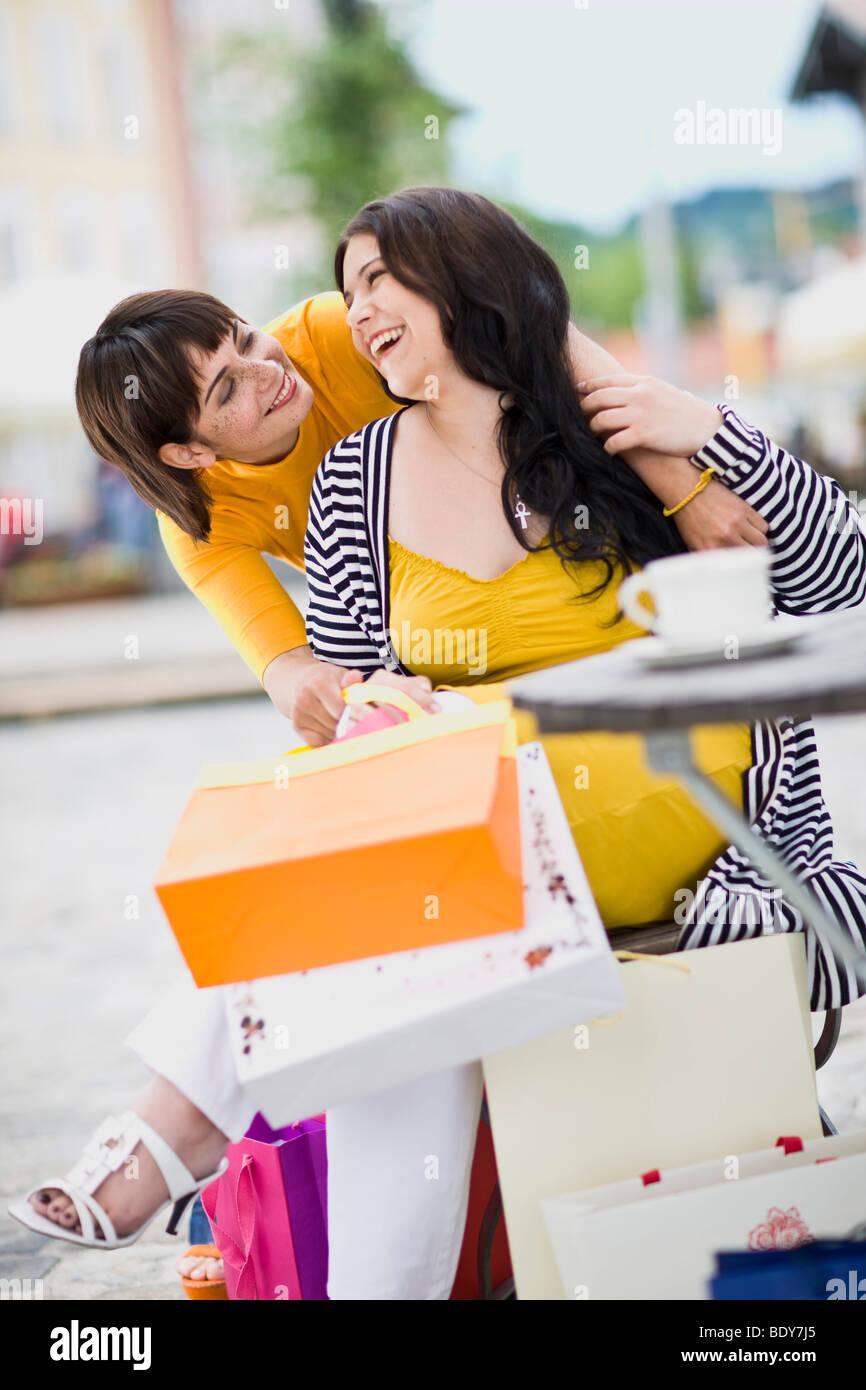 girlfriends meet at a street cafe - Stock Image