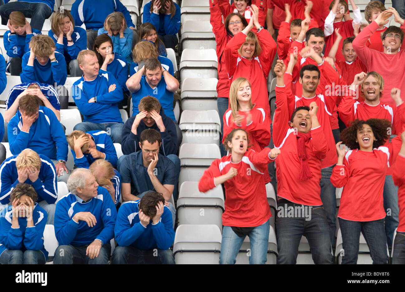 Rival fans at football match Stock Photo