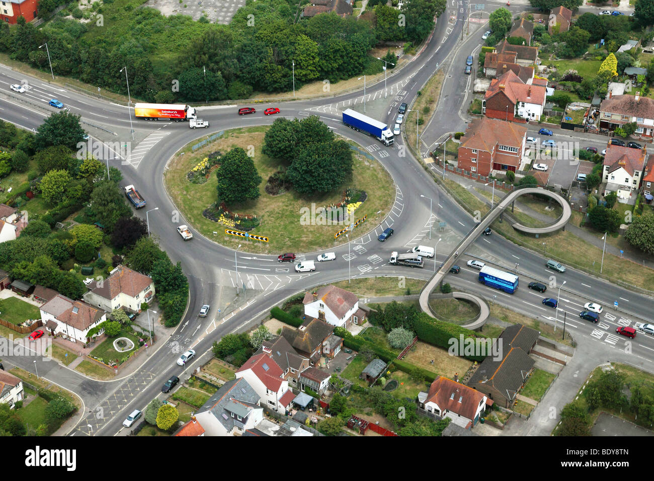 An aerial photograph of a typical roundabout junction on British roads - Stock Image