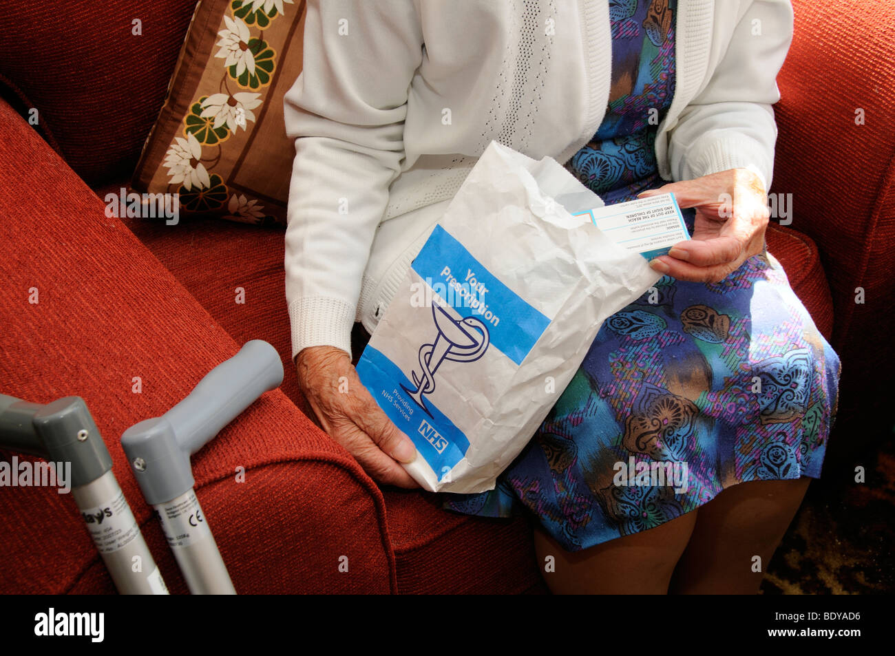 NHS prescription drugs being inspected by an old lady - Stock Image
