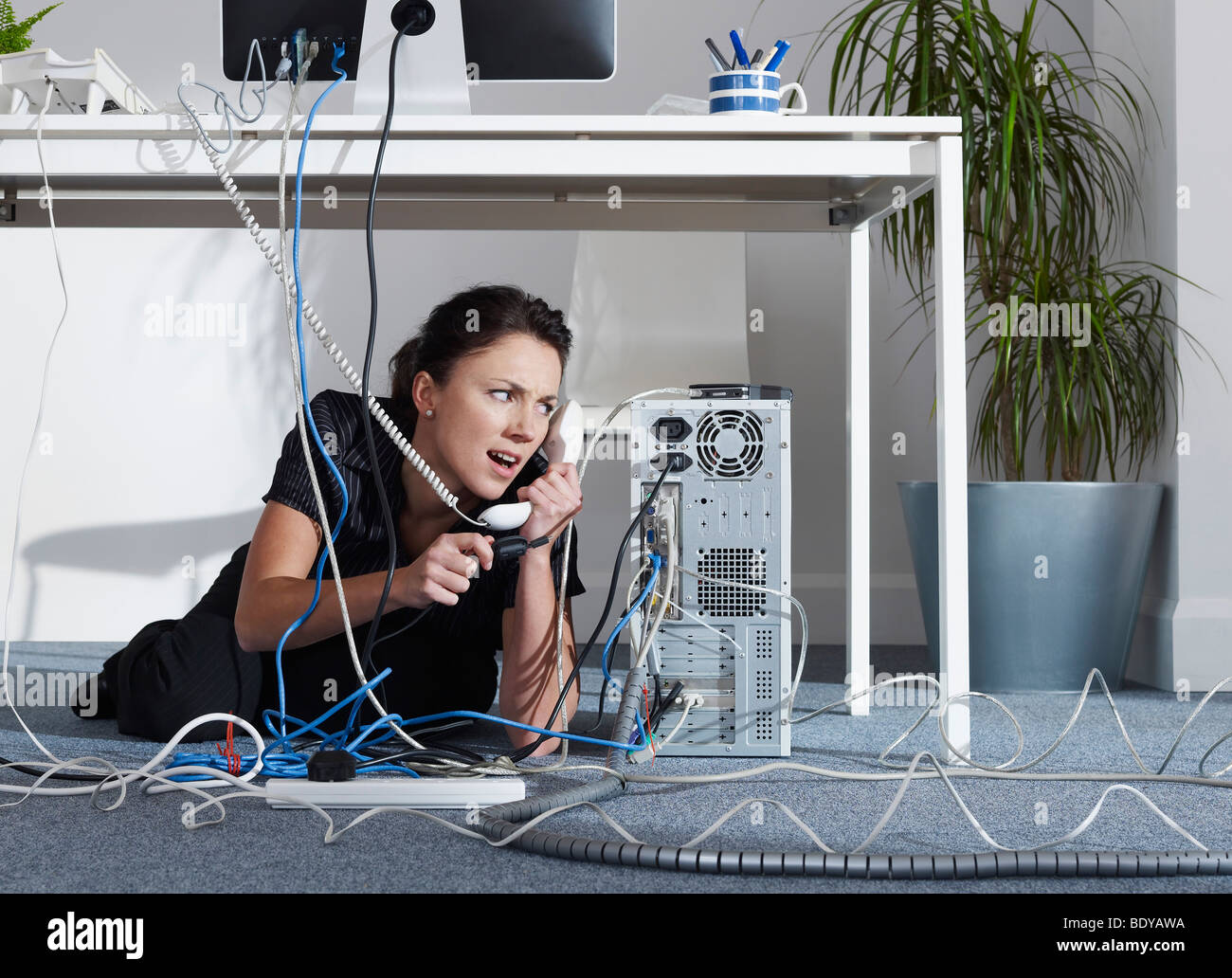 A female calling I.T support - Stock Image
