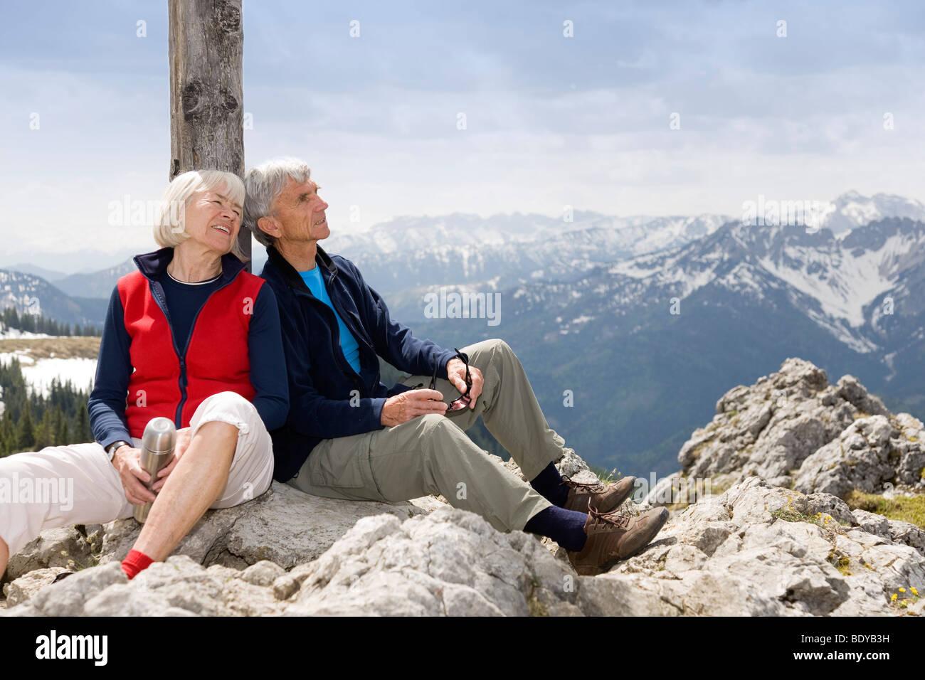 senior couple on mountain summit Stock Photo