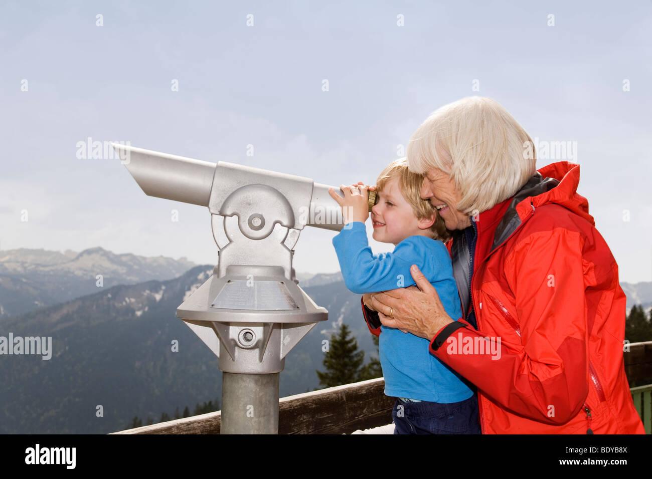boy, grandma looking through telescope - Stock Image