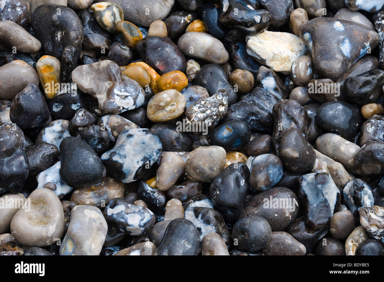 Black stones on the beach, Ault, Picardie, France, Europe - Stock Image