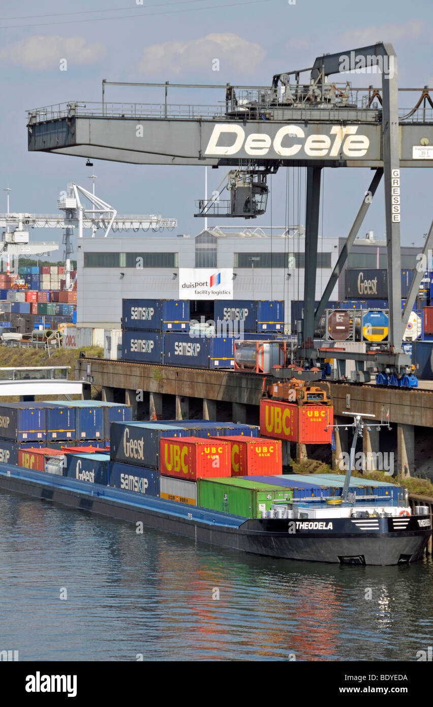 Cargo ship is being loaded, inland port in Duisburg, North Rhine-Westphalia, Germany, Europe Stock Photo