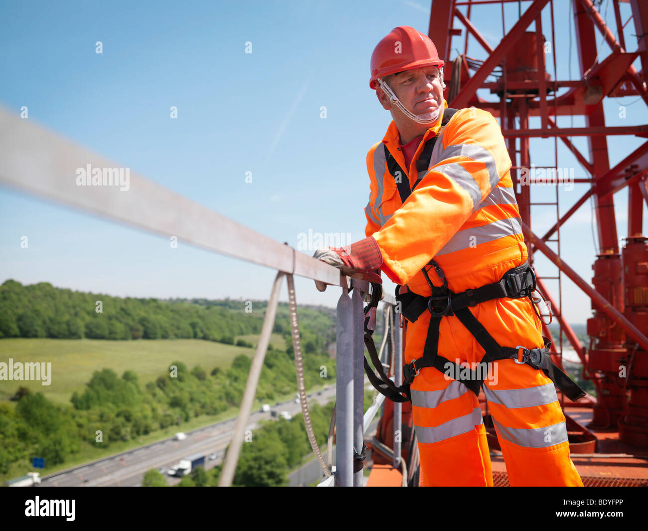 Crane Worker With Harness On Crane - Stock Image