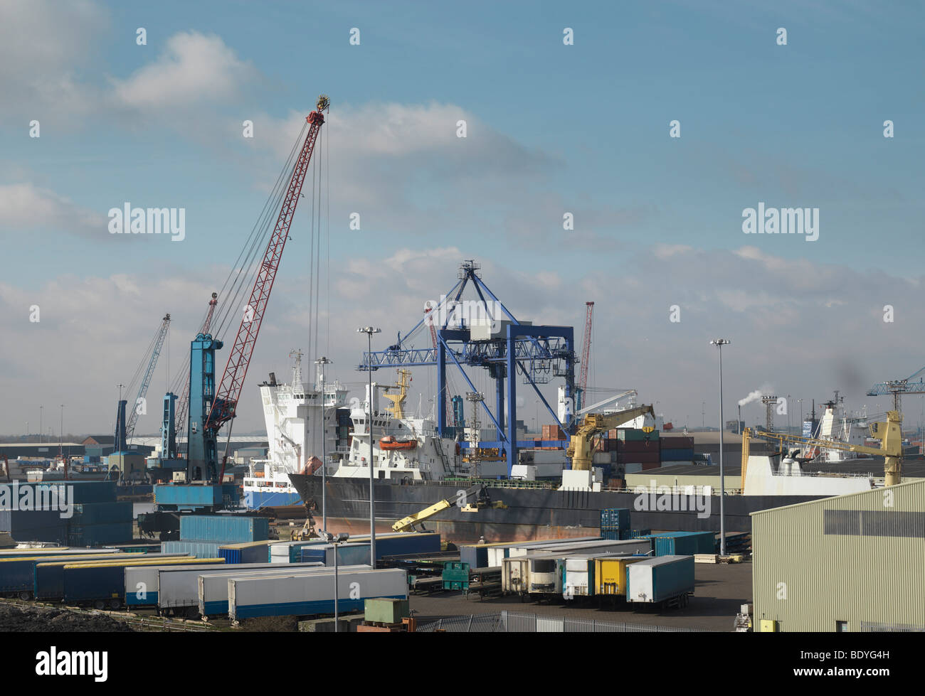 Ship Being Loaded At A Port Stock Photo