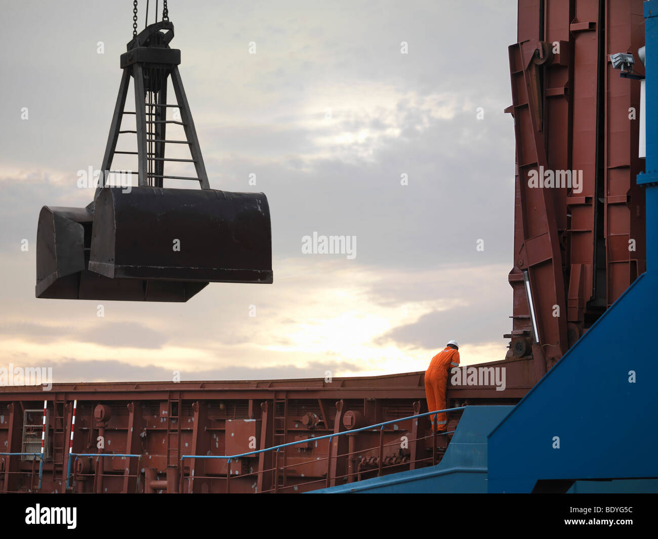 Port Worker Inspecting Cargo - Stock Image