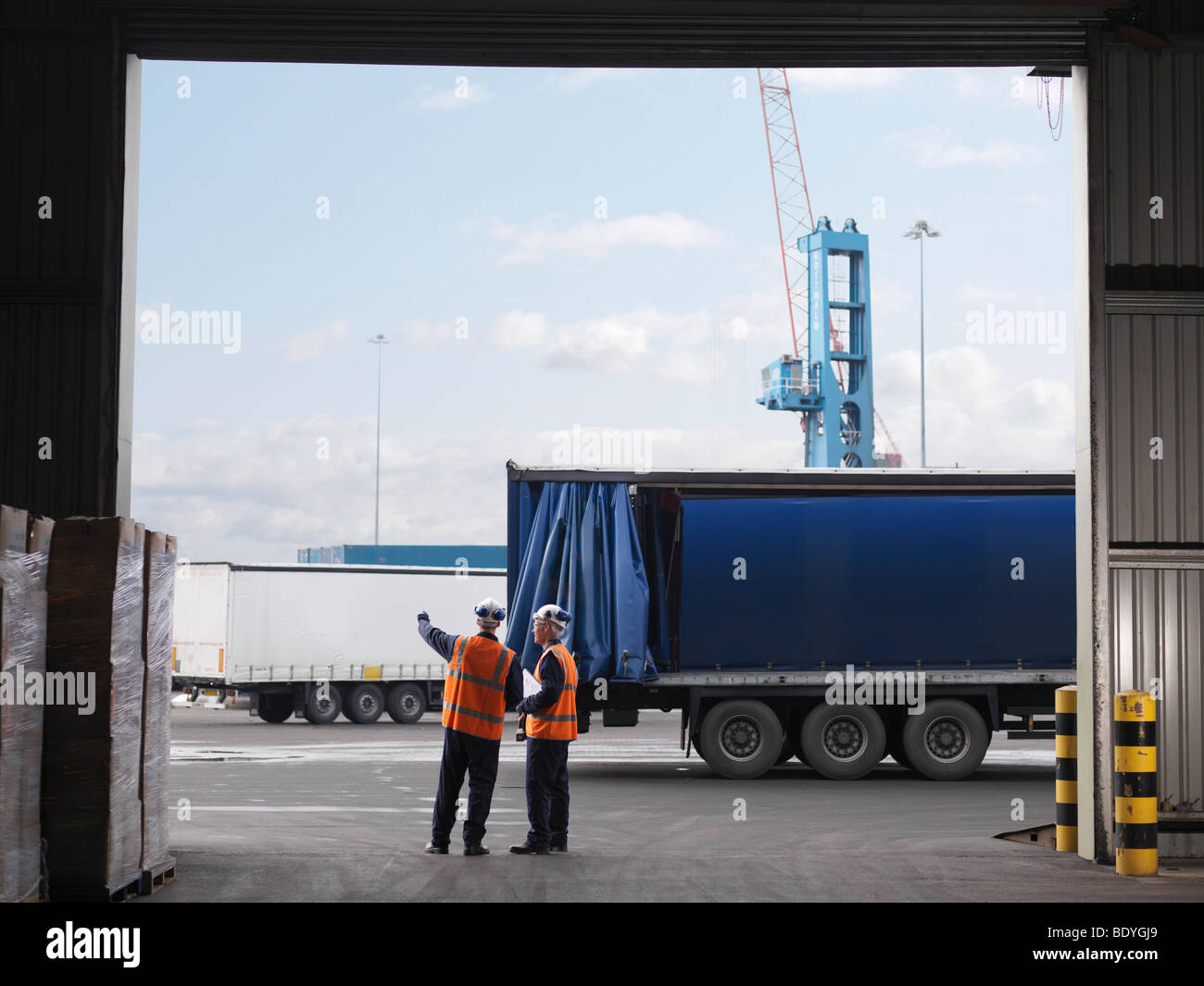 Port Workers Organizing Lorries - Stock Image