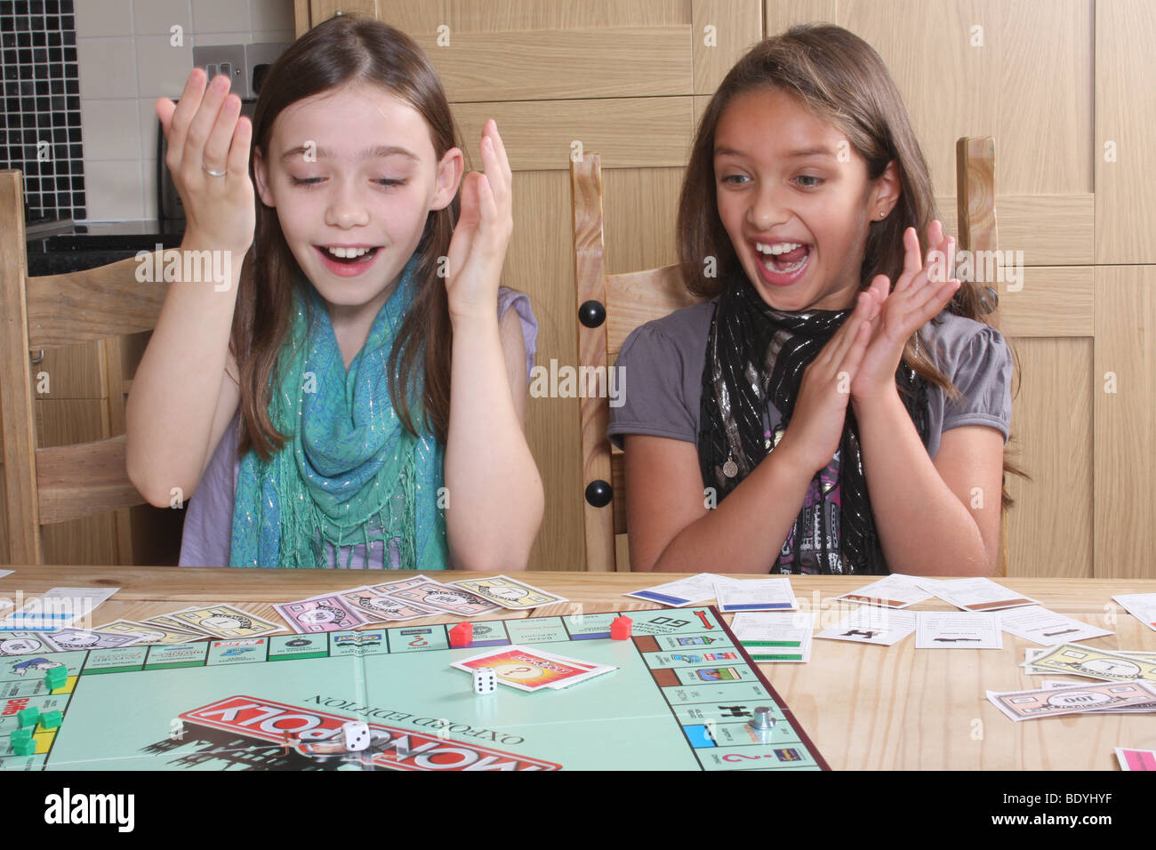 Children playing Monopoly. - Stock Image