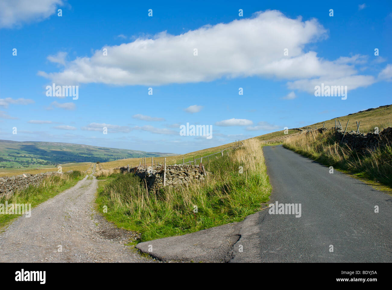 Cam High Road (Roman) on left, modern road on right. Wensleydale, Yorkshire Dales National Park, England UK - Stock Image