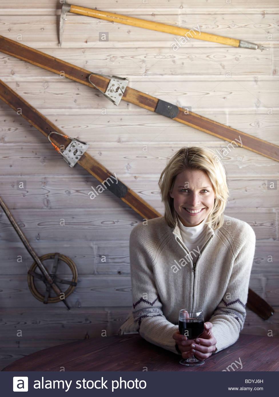 woman sitting at ski lodge table - Stock Image