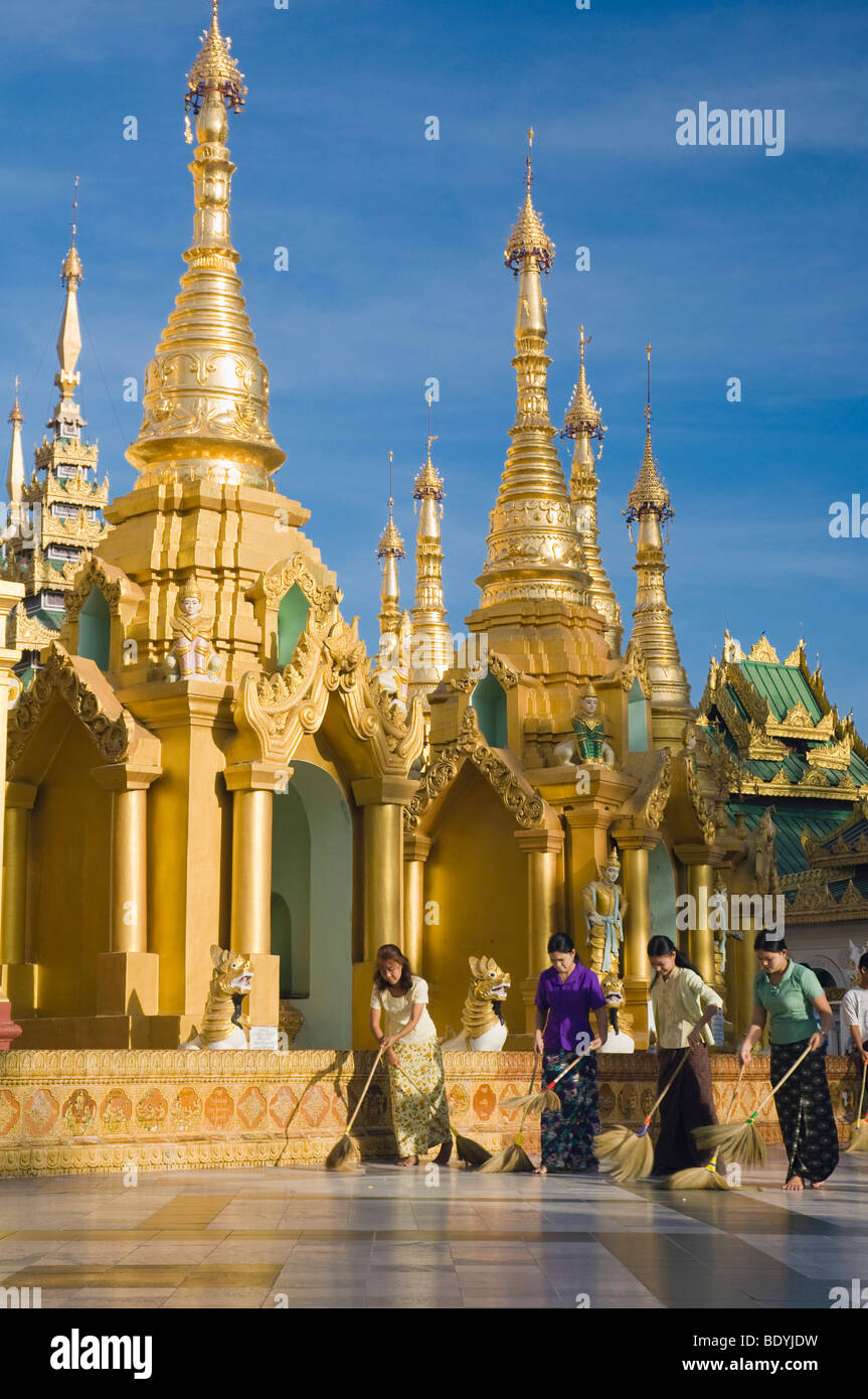 Women sweeping the Shwedagon pagoda, temple, Rangoon, Yangon, Burma, Myanmar, Asia Stock Photo