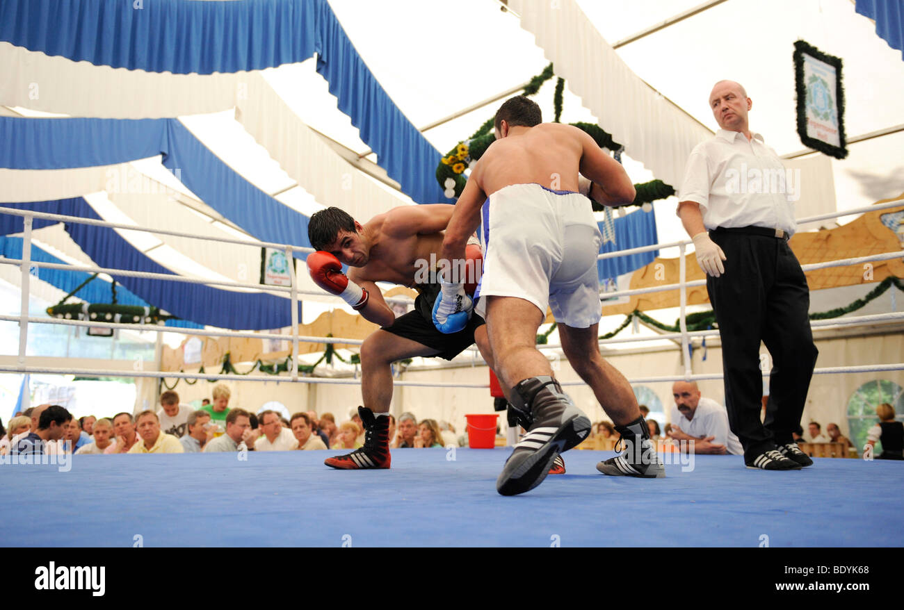 Traditional beer tent boxing at a folk festival in Geretsried, Bavaria, Germany, Europe - Stock Image