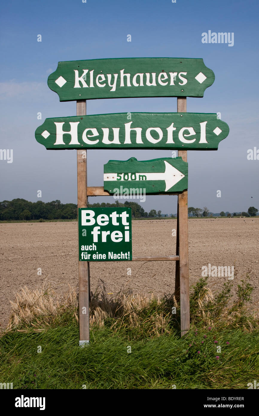 Sign for a hay hotel in an East frisian landscape, Lower Saxony, Germany, Europe - Stock Image
