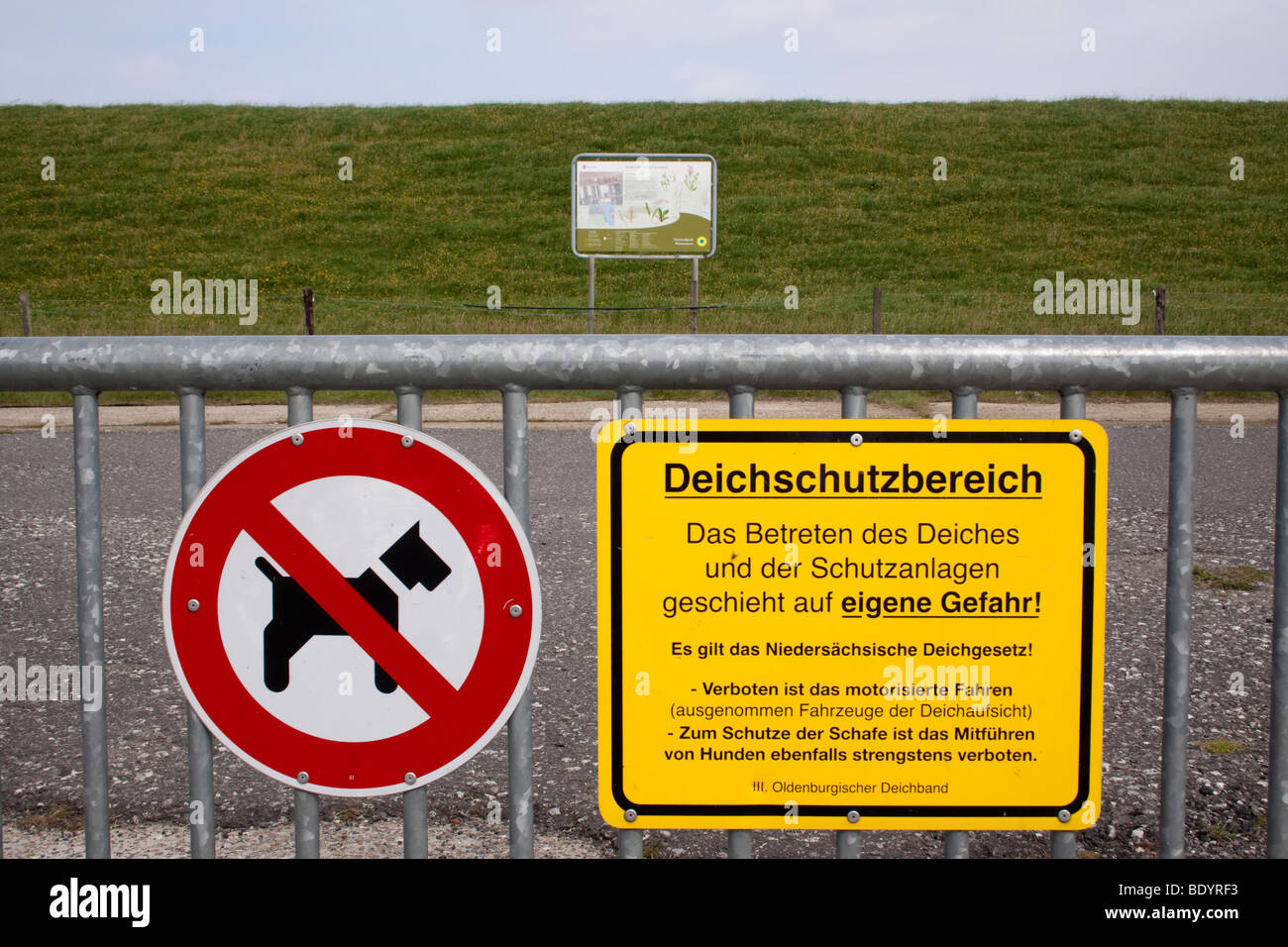 Signpost for dike foreland and dog ban - Stock Image