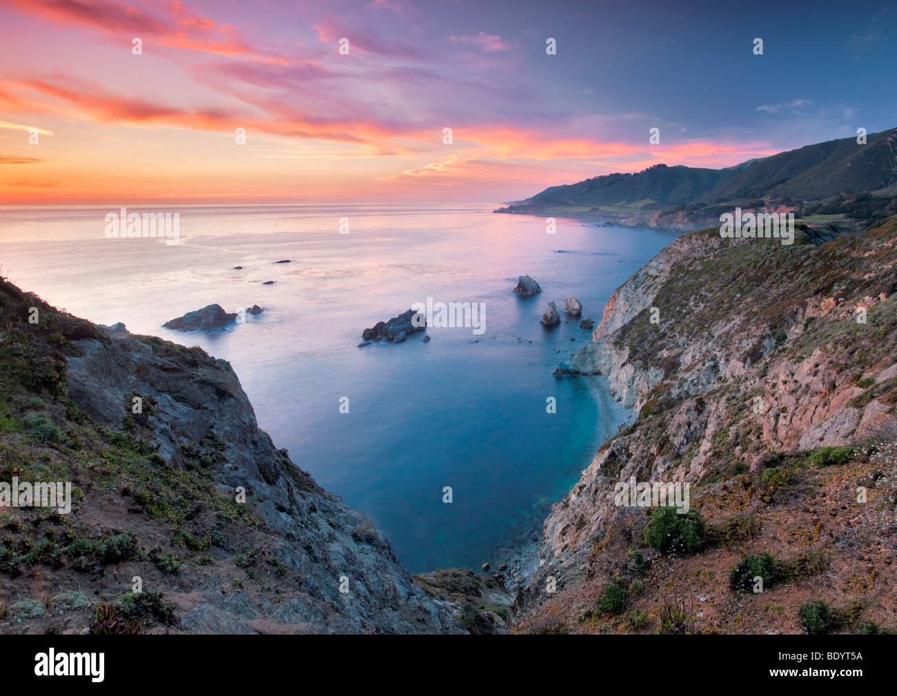 Sunset with offshore rocks. Big Sur coast. California - Stock Image
