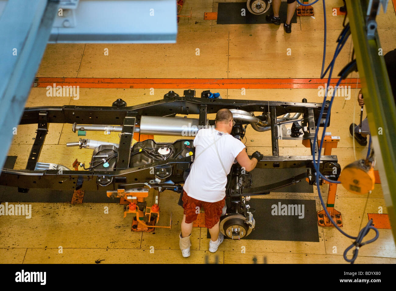 A factory worker assembles the chassis of an F-150 pickup truck on the Ford River Rouge production line in Dearborn, - Stock Image