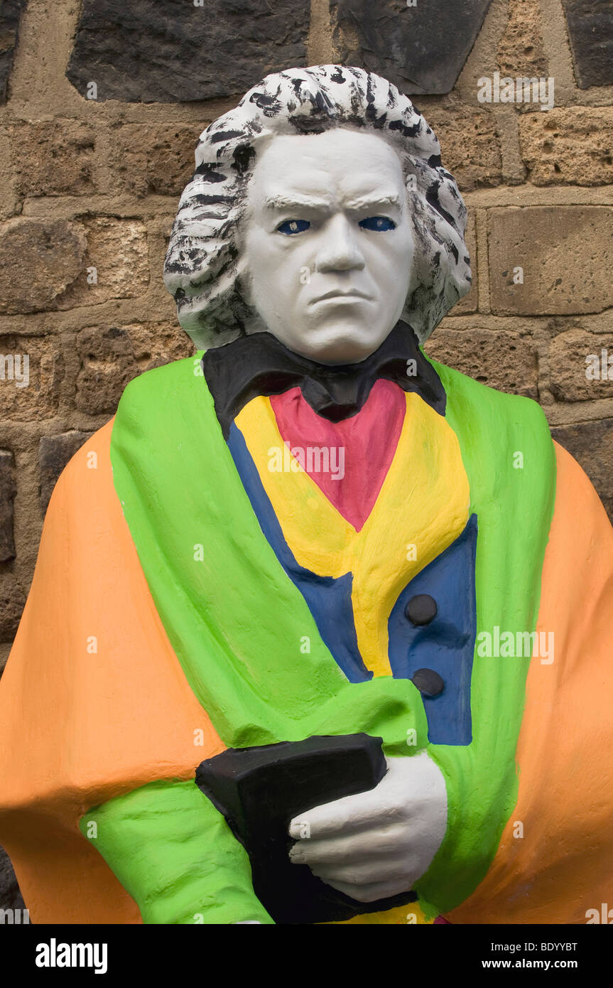 Beethoven statue in Pop Art design in front of a rustic stone wall - Stock Image