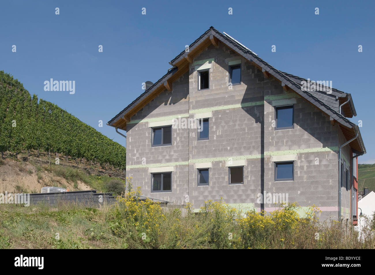 Apartment building under construction, bare brickwork in front of other homes, Rhineland-Palatinate, Germany, Europe - Stock Image