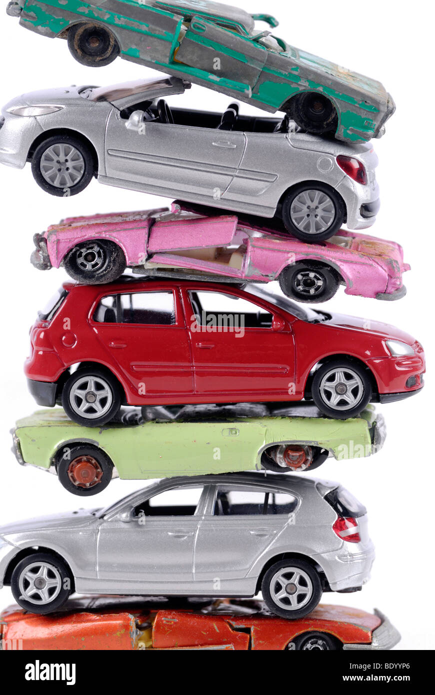 Stack of damaged and new miniature cars, a symbolic image for the faltering sale of new vehicles after the end of the scrapping Stock Photo