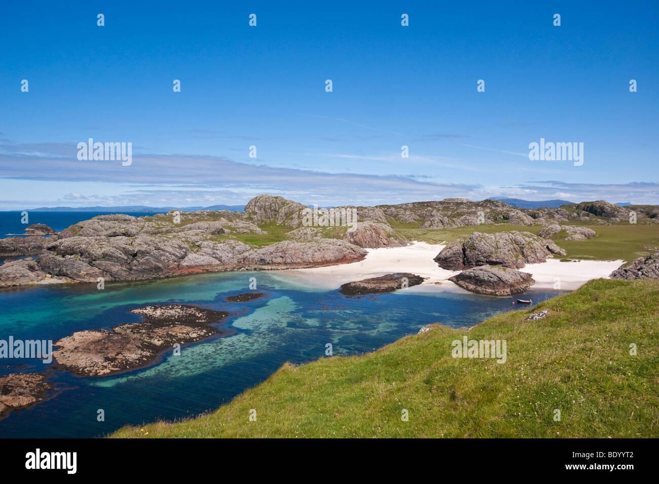 Isle of Iona Scotland - summer rocks sea and sand Port Ban - Stock Image