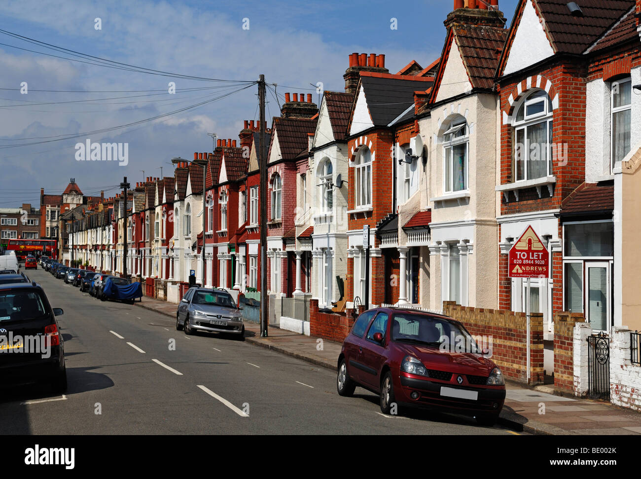 Typical English terraced houses with telephone lines, Undine Street, Tooting Broadway, London, England, Europe Stock Photo