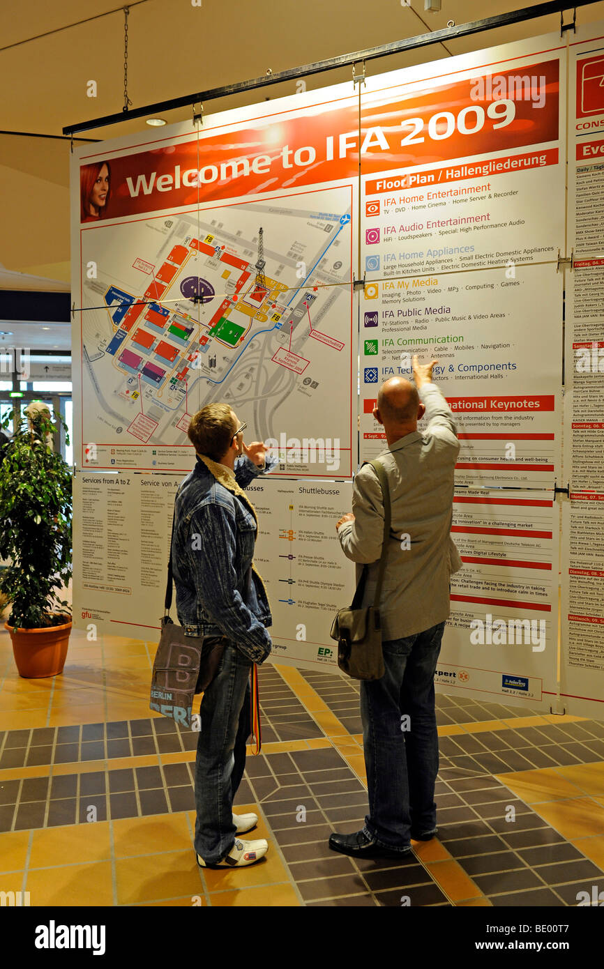 Visitors looking at a floor plan of the IFA Internationale Funkaustellung consumer electronics fair 2009 in Berlin, - Stock Image