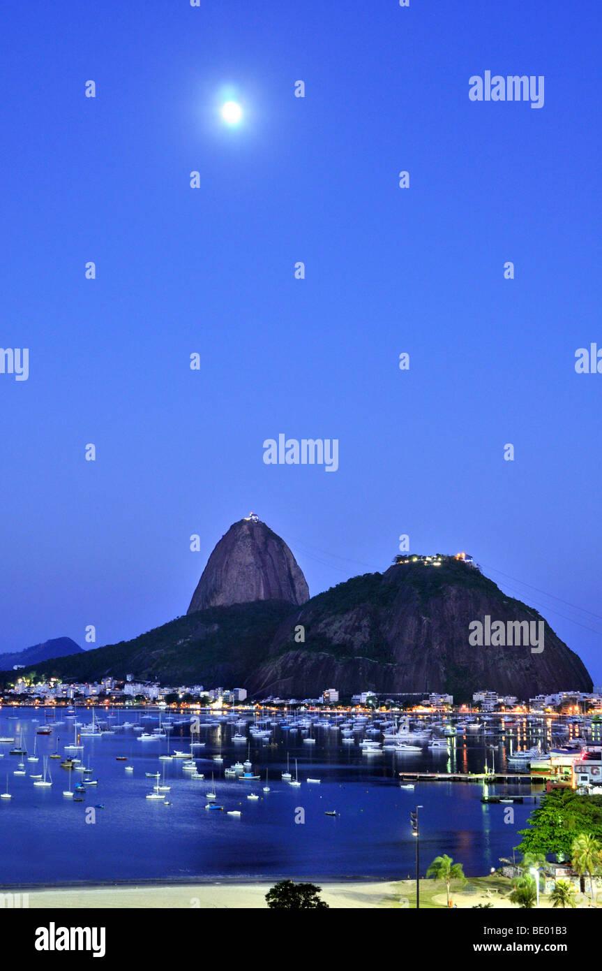 Sugarloaf Mountain, Pão de Açúcar, at night with full moon, Rio de Janeiro, Brazil, South America Stock Photo