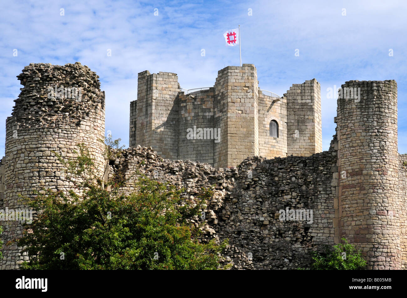 Conisbrough Castle Doncaster South Yorkshire with English Heritage flag flying - Stock Image