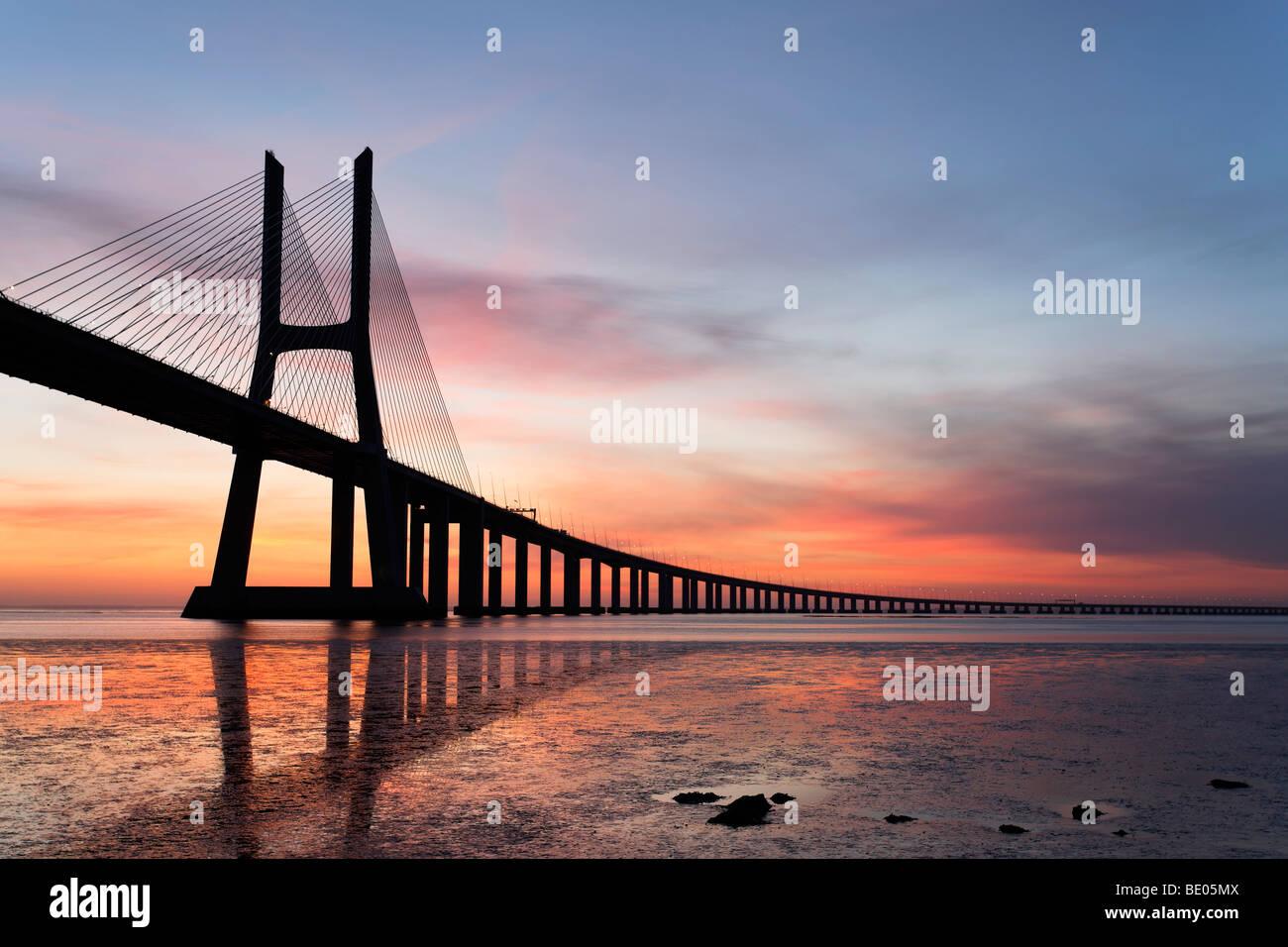 Vasco da Gama bridge at sunrise - Stock Image
