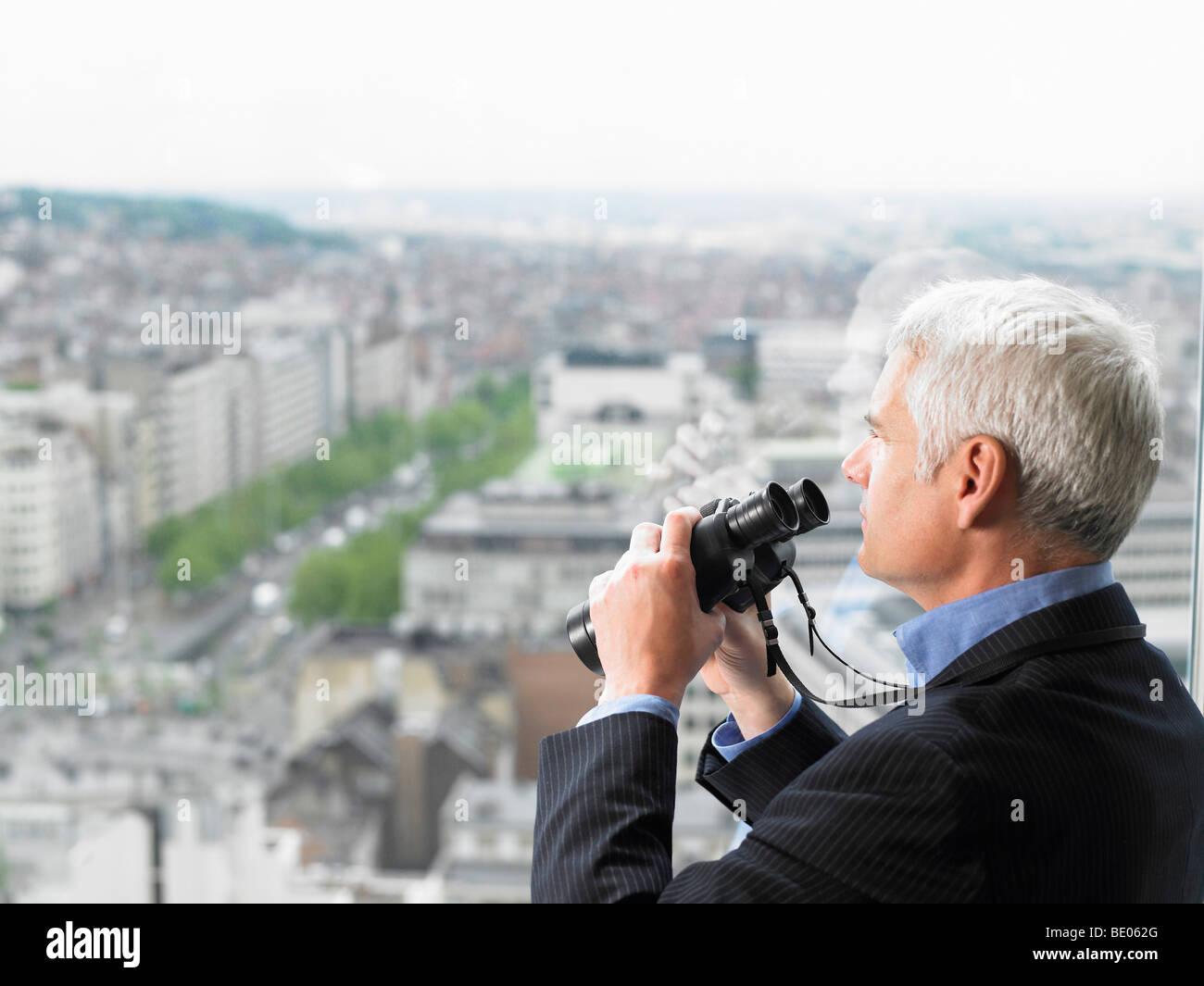Man with binoculars - Stock Image