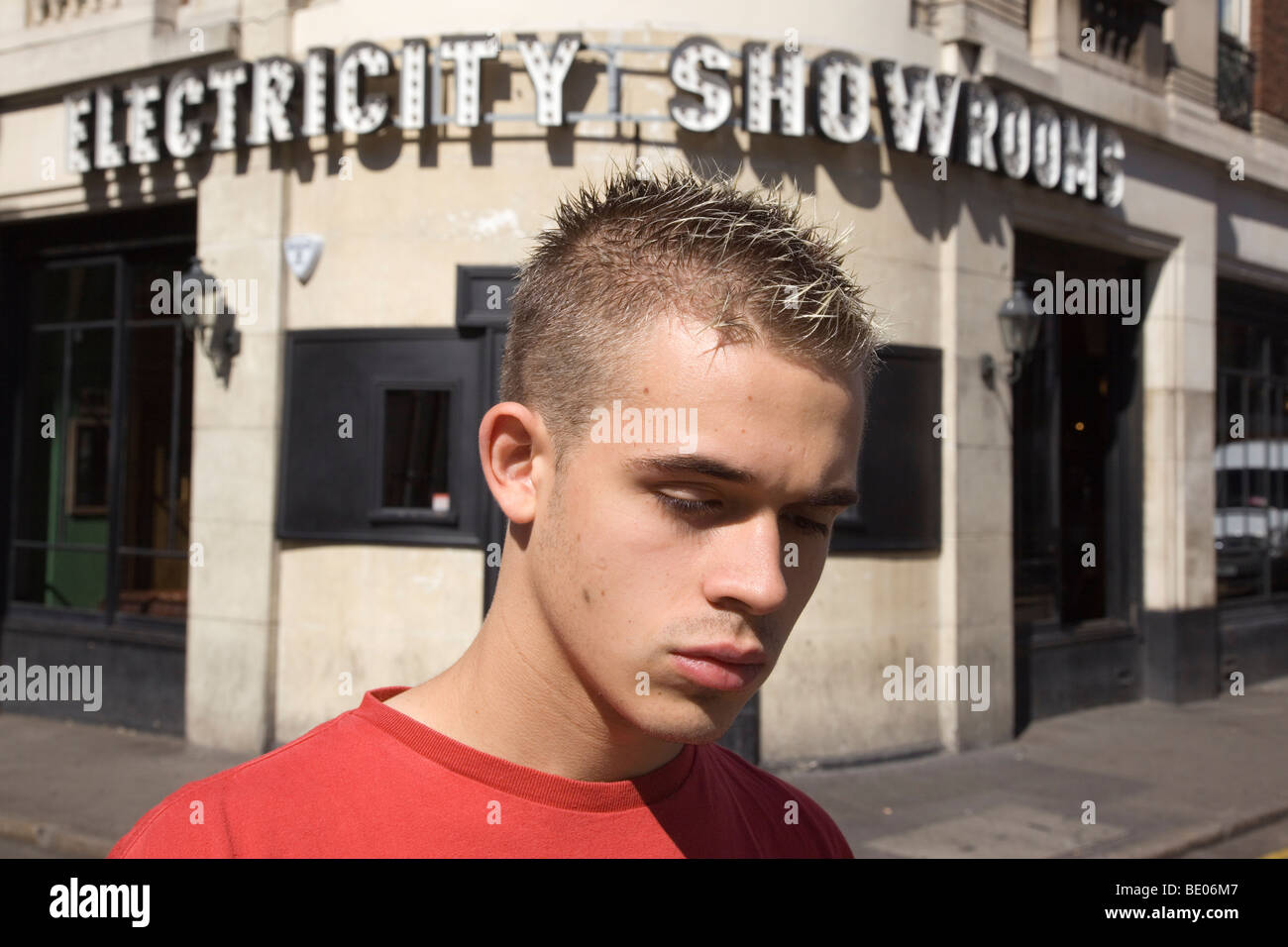 Young man with spikey short hair outside the Electricity Showrooms bar in Hoxton, London - Stock Image