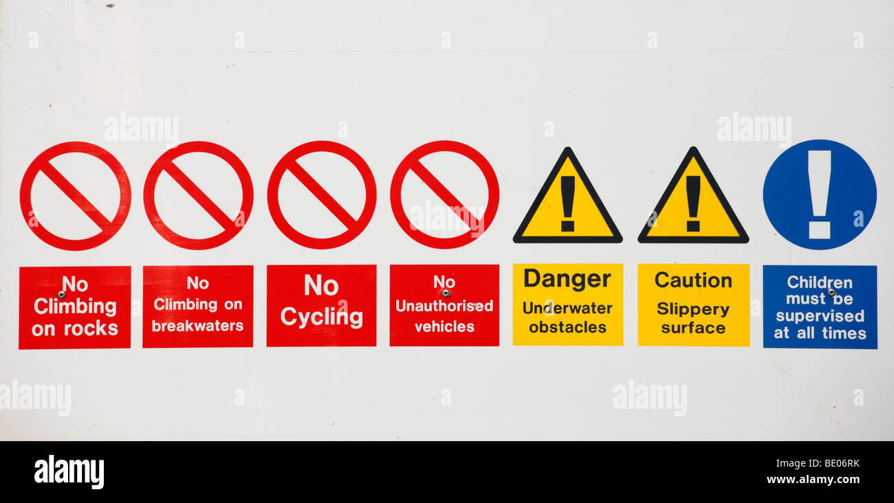 A sign giving a series of restrictions and warnings at Heacham, Norfolk, England. - Stock Image