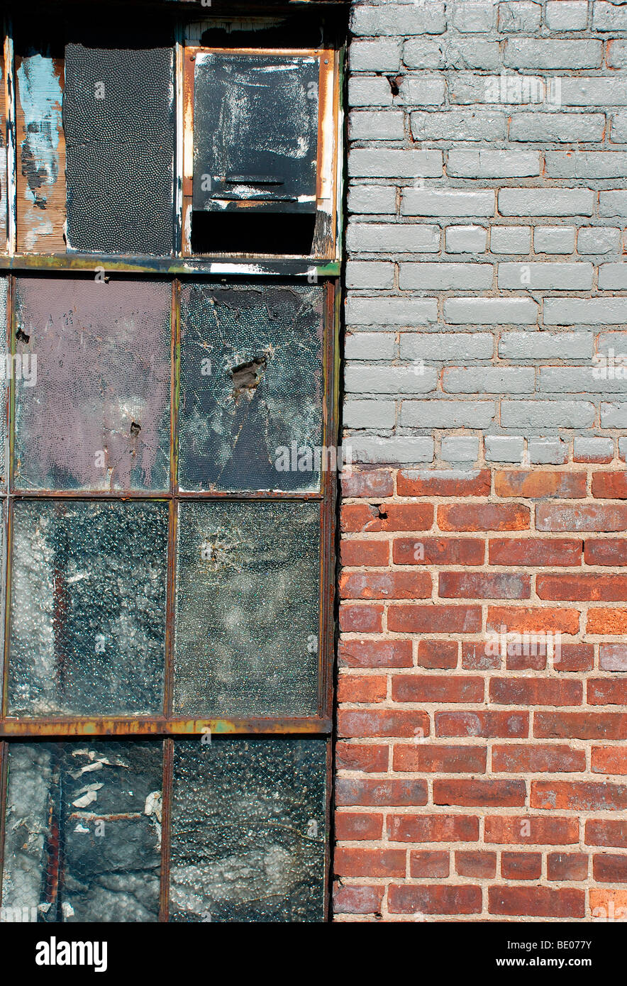 exterior view of painted windows in old brick wall Stock Photo