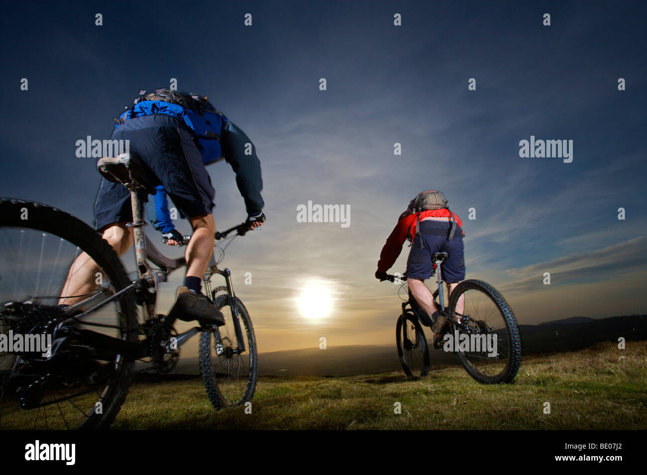Two mountain bikers riding together. - Stock Image