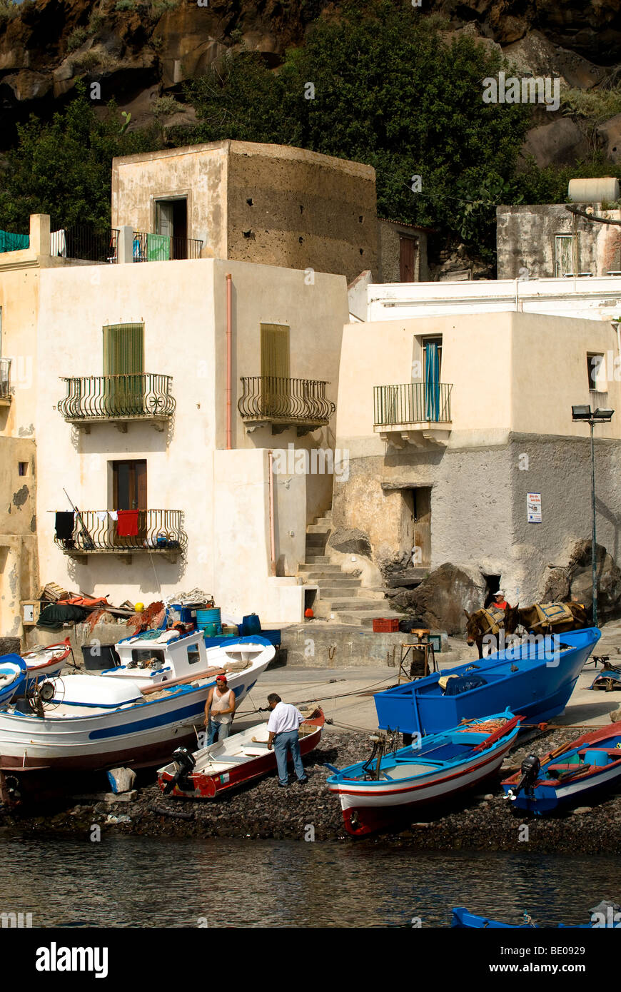 Fisherman and boats, Filicudi, Eolie Islands, Sicily, Italy Stock Photo