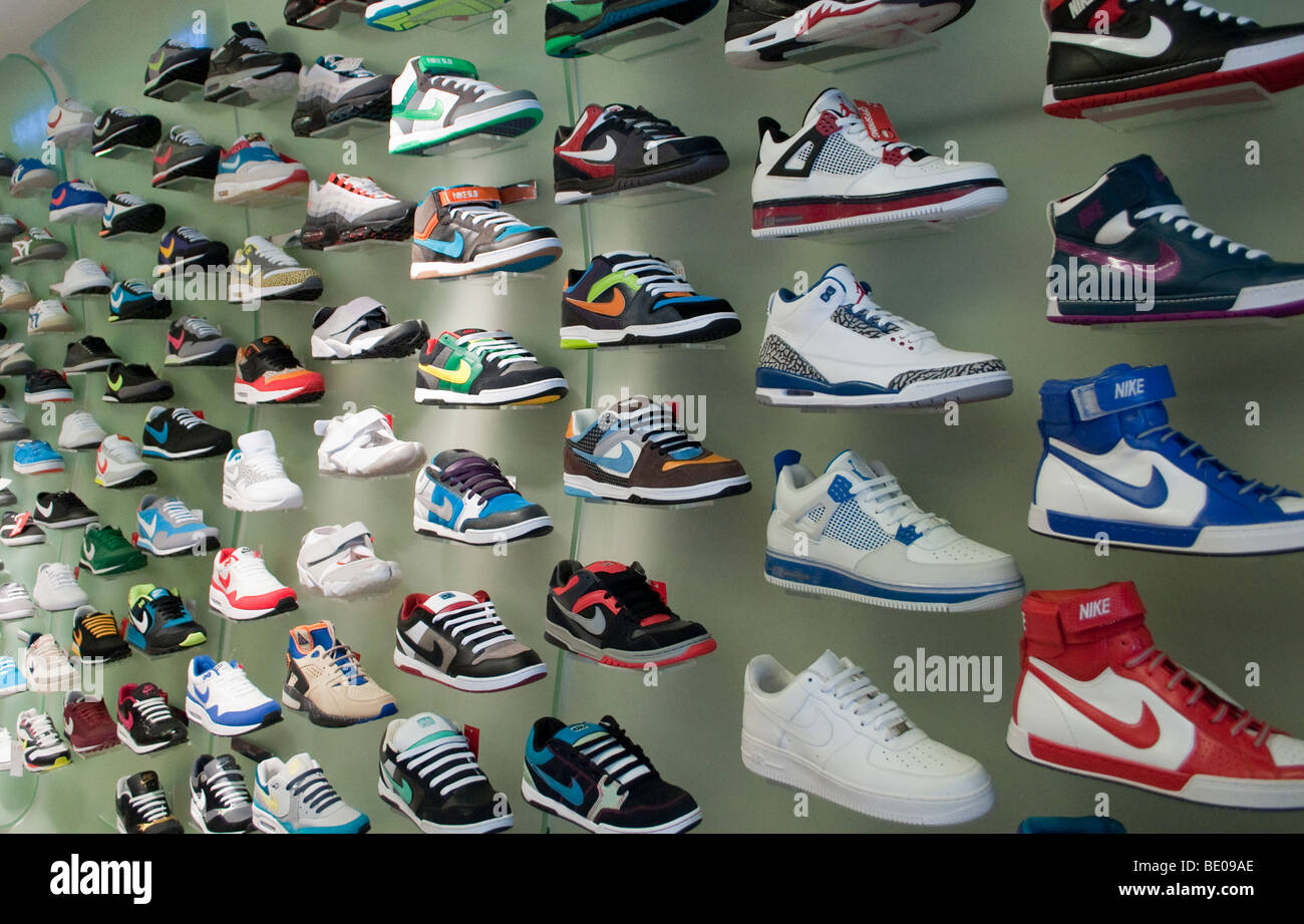 Nike trainers on display in a shoe shop - Stock Image