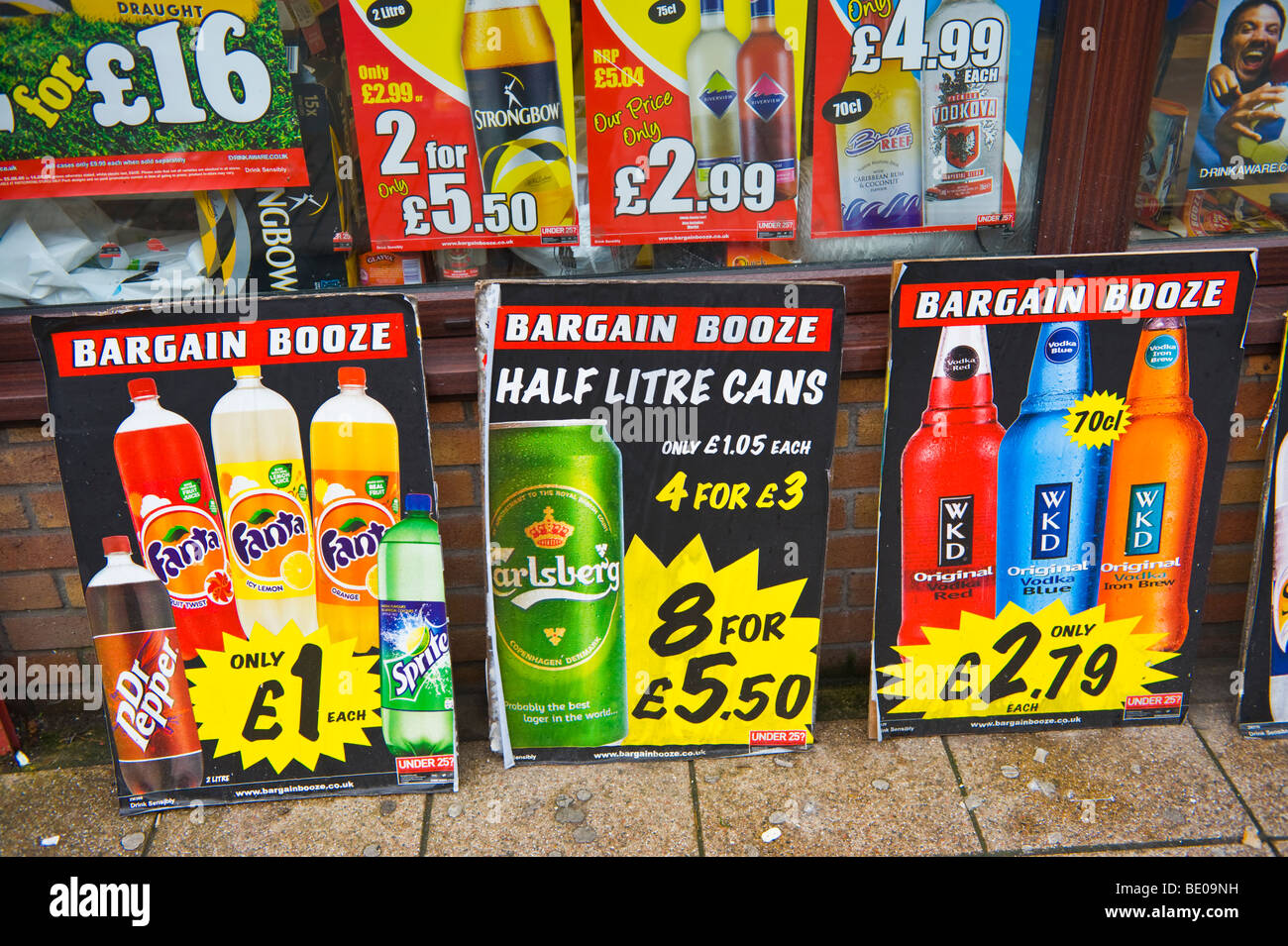 Cheap booze advertising outside local shop in Neath South Wales UK - Stock Image