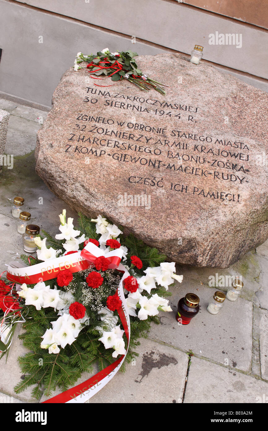 Warsaw Uprising street memorial  here on 30th August 1944 in Ulica Zakroczymska 32 members of the Home Army AK died - Stock Image