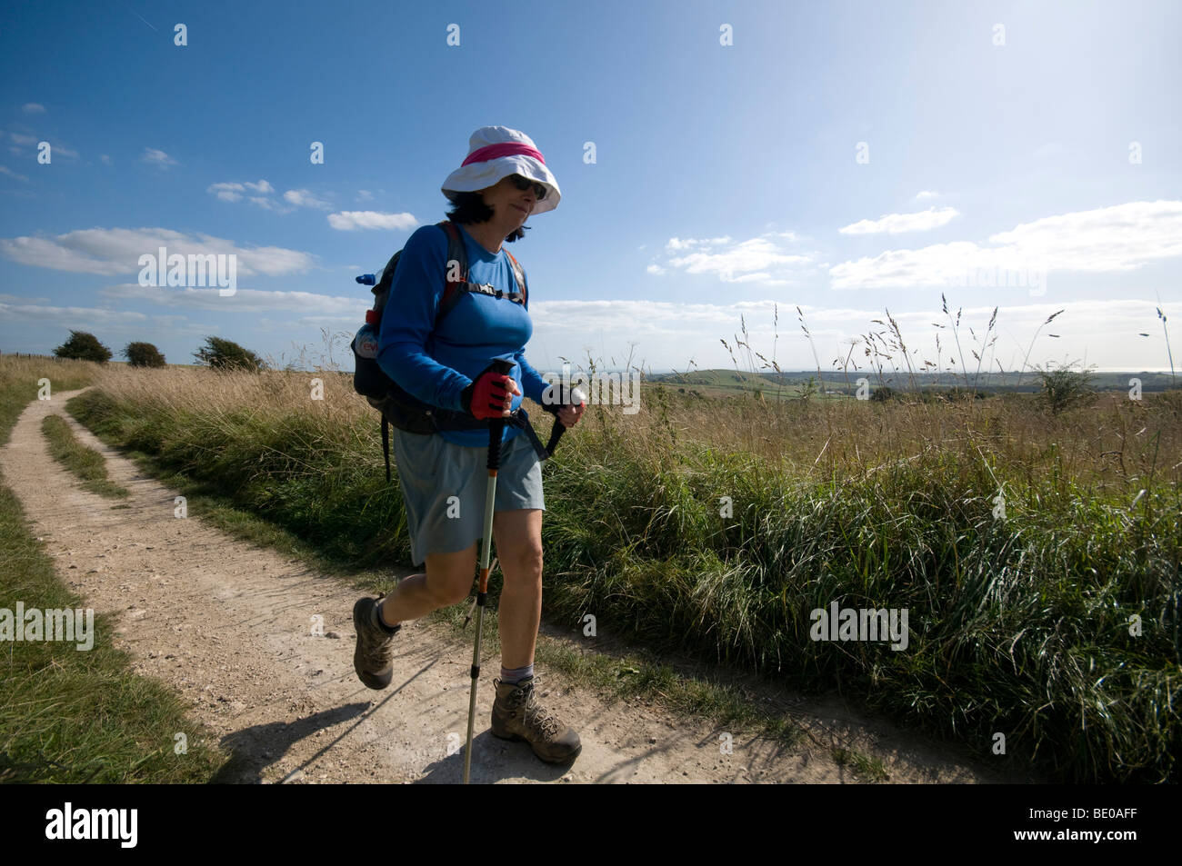 Walkers on the South Downs Sussex Downs use pathway - Stock Image
