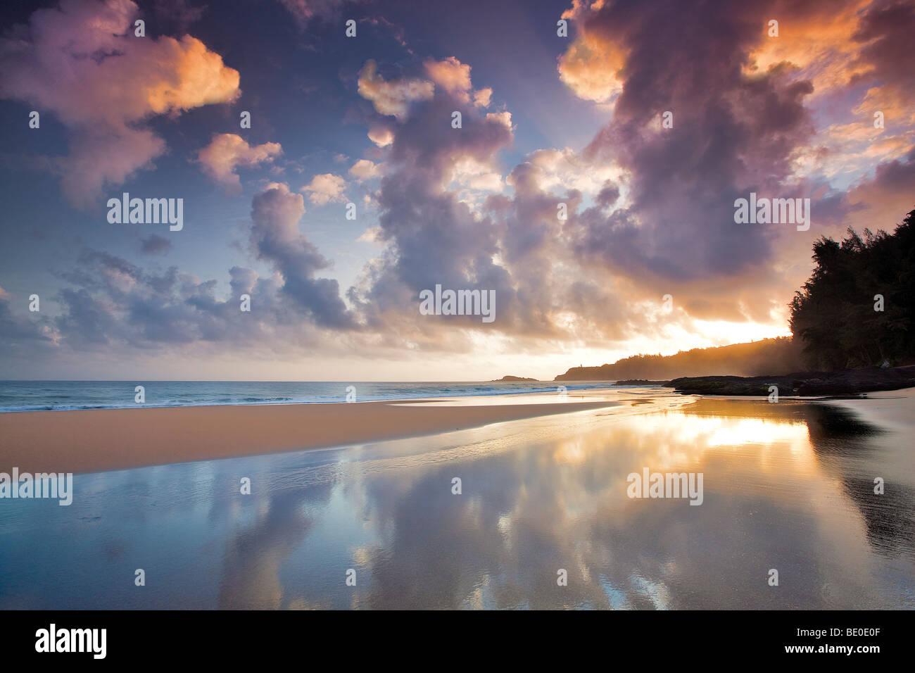 Sunrise at low tide at Secret Beach. Kauai, Hawaii. Stock Photo