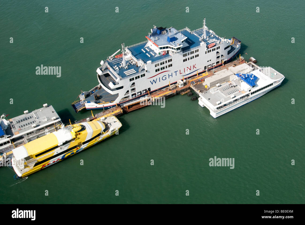wight link and fast cat ferries moored portsmouth harbour Stock Photo