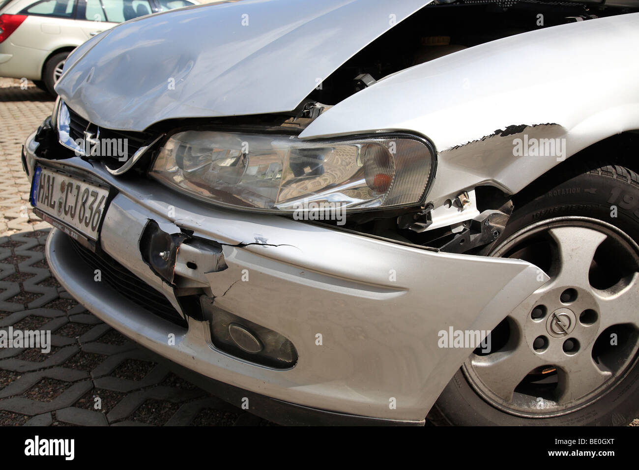 damaged front of a car (Opel Vectra) after an accident - Stock Image