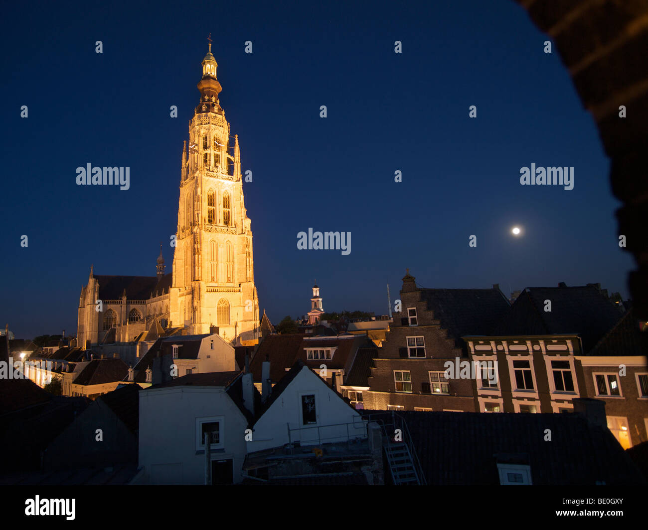 The Grote Kerk or Grand Church of Breda, Noord Brabant, the Netherlands, is illuminated at night - Stock Image
