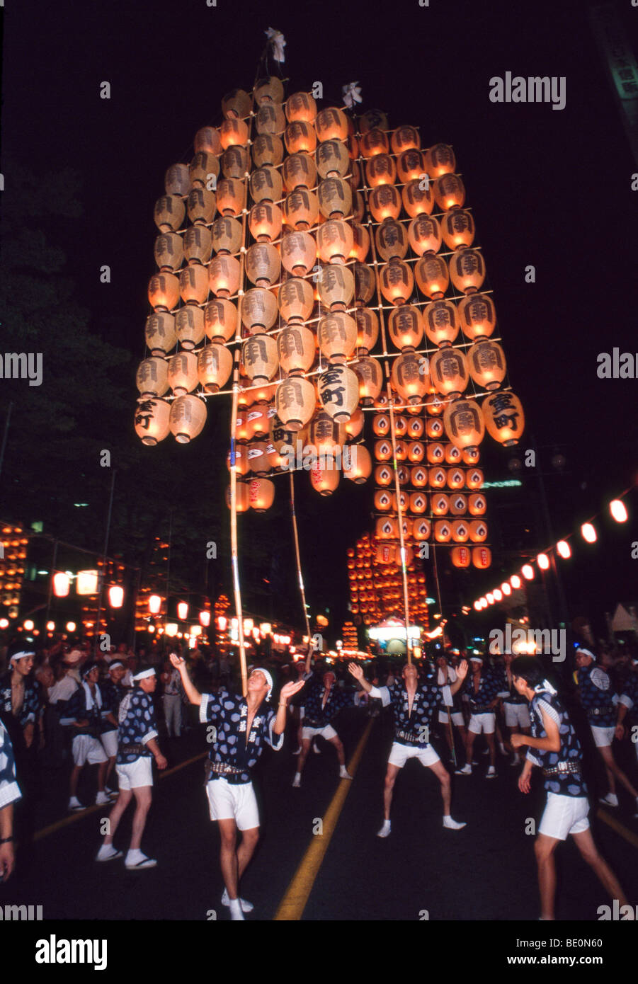 Festival participants balance lighted paper lanterns Kanto matsuri (festival), Akita Japan Stock Photo